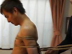 Japanese stud gets required in the air kinbaku similar to by gay amateur
